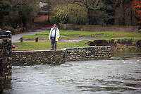Pictured: A man stands by river Ogmore near Stormy Down, Wales, UK. Tuesday 22 November 2016<br />