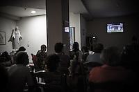 Pilgrims watching the final soccer match of Euro 2012 in the house of Mirjana Dragićević. <br /> Bijakovici, Medjugorje, Bosnia and Herzegovina.