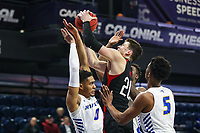 Washington, DC - March 10, 2020: Northeastern Huskies guard Bolden Brace (20) grabs a rebound during the CAA championship game between Hofstra and Northeastern at  Entertainment and Sports Arena in Washington, DC.   (Photo by Elliott Brown/Media Images International)