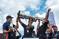 The Great Sound, Bermuda, 26th June 2017. Emirates Team New Zealand helmsman Peter Burling and trimmer Blair Tuke help shore crew manager Sean Regan to drink Moet champagne from the America's Cup.<br /> Vela Coppa America 2017 <br /> Foto Chris Cameron / Panoramic / Insidefoto