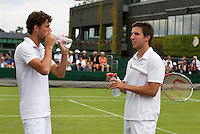 26-06-13, England, London,  AELTC, Wimbledon, Tennis, Wimbledon 2013, Day two, Doubles Igor Sijsling(R) and Robin Haase (NED)<br /> <br /> <br /> <br /> Photo: Henk Koster