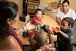 Education Preschool Phase-in First Days of School 2s Program two teachers with 3 children