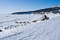 Matt Hayashida runs onto the Bering Sea ice as he leaves the Elim checkpoint during the 2010 Iditarod
