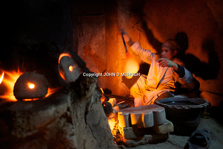 A glassmaker is seen producing handmade glass in his traditional furnace, Herat 18 September 2013. The furnace is believed to be the last one remaining in existence. (John D McHugh)
