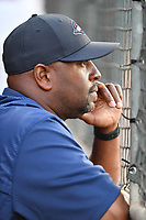Billy McMillon, outfield and base running coordinator for the Boston Red Sox, watches the Greenville Drive in a game against the Lexington Legends on Wednesday, April 12, 2017, at Fluor Field at the West End in Greenville, South Carolina. Greenville won, 4-1. (Tom Priddy/Four Seam Images)