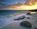 Anguilla, BWI<br /> Caribbean sunrise over the Atlantic Ocean with reflections on a pocket beach near Island Harbor