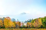 Mount Chocorua rises above a heavy fog in Chocorua, New Hampshire, USA