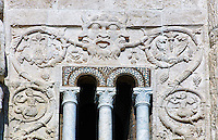 13th century reilief sculpture depicting the Kingdom of Evil with three faced demons with a snake in its arms and branches and leaves growing from its mouth of the 8th century Romanesque Basilica church of St Peters, Tuscania, Lazio, Italy
