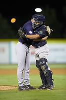 Pulaski Yankees catcher Gustavo Campero (24) hugs relief pitcher Hayden Wesneski (71) after getting the final out of the game against the Burlington Royals at Burlington Athletic Stadium on August 25, 2019 in Burlington, North Carolina. The Yankees defeated the Royals 3-0. (Brian Westerholt/Four Seam Images)