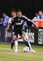 Arturo Alvarez (10) controls the ball ahead of A.J. DeLaGarza (20). San Jose Earthquakes tied Los Angeles Galaxy 1-1 at the McAfee Colisum in Oakland, California on April 18, 2009.
