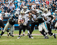 The Carolina Panthers played the New Orleans Saints for supremacy in the NFC South.  December 22, 2013 at Bank of America Stadium.  The Panthers scored the winning touchdown with 23 seconds left in the game to give them the opportunity to clinch the NFC South with a win next week.  New Orleans Saints quarterback Drew Brees (9) is sacked by Carolina Panthers defensive end Mario Addison (97) and Carolina Panthers defensive end Greg Hardy (76)