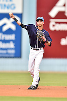 Asheville Tourists shortstop Emerson Jimenez #14 throws to first during a game against the Kannapolis Intimidators at McCormick Field on June 5, 2014 in Asheville, North Carolina. The Intimidators defeated the Tourists 5-3. (Tony Farlow/Four Seam Images)