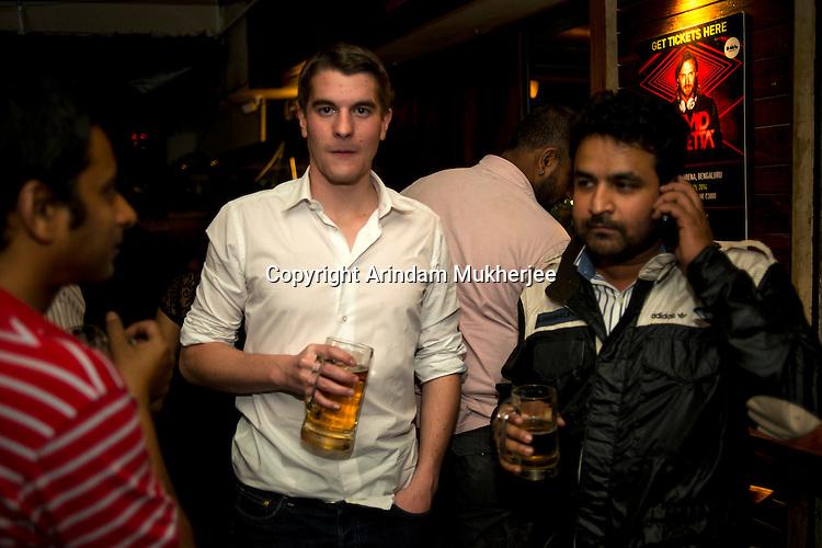 Young boys enjoy drink at a pub in Bangalore, Karnataka, India.