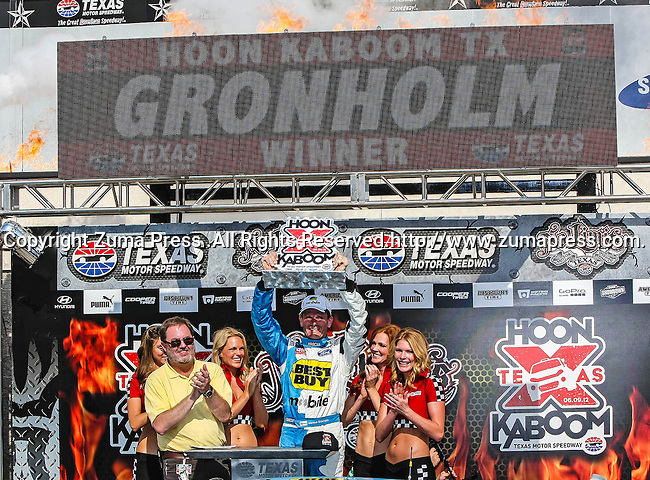 Marcos Gronholm (3) driver of the Best Buy Mobile car, in action during the Global Rally Cross race, the Hoon Kaboom, at Texas Motor Speedway in Fort Worth,Texas. Global Rally Cross driver Marcos Gronholm (3) wins the Hoon Kaboom race..