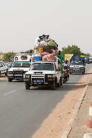 Senegal, Touba.  Traffic Safety.  Passenger Riding on Top, Unsecured.