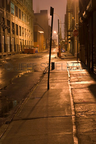 THIS PHOTO IS AVAILABLE EXCLUSIVELY FROM GETTY IMAGES.....PLEASE SEARCH FOR IMAGE # 200535102-001 ON WWW.GETTYIMAGES.COM.....Mysterious Urban Street Scene Illuminated at Night, in the DUMBO neighborhood of Brooklyn, New York City, New York State, USA