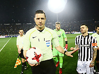 Pictured: Match referee Alexandros Aretopoulos walks off the pitch at Toumba Stadium in Thessaloniki, Greece. Sunday 25 February 2018<br /> Re: Sunday's Greek Super League derby between PAOK Thessaloniki and Olympiakos was called off after Olympiakos' manager Oscar Garcia was struck in the face by an object believed to be a till machine paper roll, thrown by a spectator minutes before kick-off.<br /> Garcia left Toumba Stadium for a local hospital to seek treatment for a bloodied lip.<br /> The incident prompted the Olympiakos team to leave the pitch in protest before riots erupted outside the ground.<br /> Angry PAOK fans leaving the stadium then clashed with police who used tear gas to quell the violence.