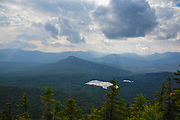 Storm clouds over Sawyer Pond from the summit of Mount Tremont in the White Mountains, New Hampshire.