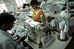 An indian man using Juki Singer machine (single needle lock stitch) at Popy's garment stitching factory in Tirupur, Tamilnadu. After lifting of quota system in textile export on 1st january 2005. Tirupur has become the biggest foreign currency earning town of India.