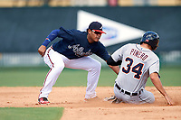 Atlanta Braves shortstop Kevin Maitan (50) tags Danny Pinero (34) sliding safely into second base after a pickoff attempt during an Instructional League game against the Detroit Tigers on October 10, 2017 at the ESPN Wide World of Sports Complex in Orlando, Florida.  (Mike Janes/Four Seam Images)