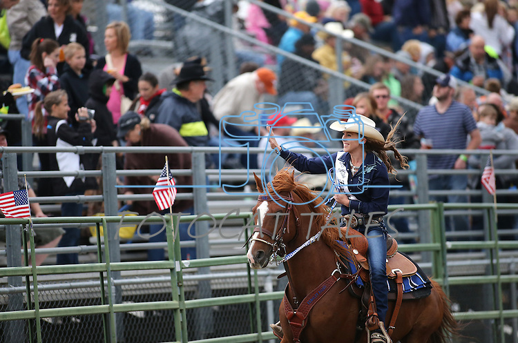 Fernley Rodeo Association Jr. Princess rides through the arena at the Smackdown at Fuji Park in Carson City, Nev., on Friday, June 5, 2015. <br /> Photo by Cathleen Allison/Nevada Photo Source