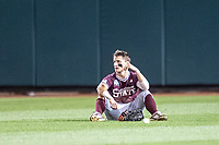 Mississippi State Bulldogs outfielder Jake Mangum (15) watches Louisville celebrate winning Game 10 of the NCAA College World Series against the Louisville Cardinals on June 20, 2019 at TD Ameritrade Park in Omaha, Nebraska. Louisville defeated Mississippi State 4-3. (Andrew Woolley/Four Seam Images)