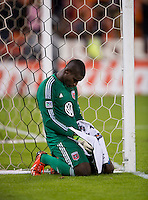 Bill Hamid (28) of D.C. United sits near his goal after a Major League Soccer game at RFK Stadium in Washington, DC. D.C. United tied the Philadelphia Union, 1-1.