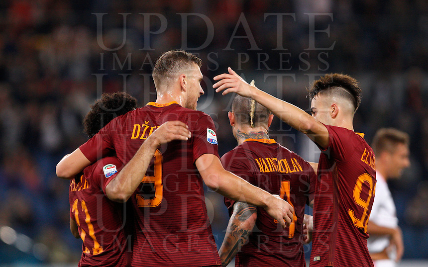 Calcio, Serie A: Roma vs Palermo. Roma, stadio Olimpico, 23 ottobre 2016.<br /> Roma's Edin Dzeko, second from left, celebrates with teammates Mohamed Salah, left, Radja Nainggolan, second from right, and Stephan El Shaarawy, after scoring during the Italian Serie A football match between Roma and Palermo at Rome's Olympic stadium, 23 October 2016. Roma won 4-1.<br /> UPDATE IMAGES PRESS/Riccardo De Luca
