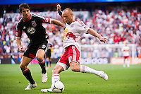 Joel Lindpere (20) of the New York Red Bulls is defended by Dejan Jakovic (5) of DC United. The New York Red Bulls defeated DC United 3-2 during a Major League Soccer (MLS) match at Red Bull Arena in Harrison, NJ, on June 24, 2012.