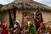 Women and their children meet for a weekly meeting to discuss health related issues in Bhelaiya village in Raxaul district in Bihar, India.