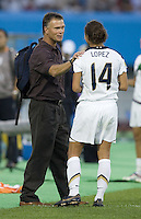 USA head coach Greg Ryan talks with defender (14) Stephanie Lopez after the match. The USA defeated Sweden 2-0 during their Group B first round game at the 2007 FIFA Women's World Cup at Chengdu Sports Center Stadium in Chengdu, China on September 14, 2007.