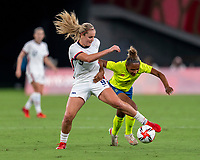 TOKYO, JAPAN - JULY 21: Lindsey Horan #9 of the USWNT fights for the ball with Madelen Janogy #7 of Sweden during a game between Sweden and USWNT at Tokyo Stadium on July 21, 2021 in Tokyo, Japan.