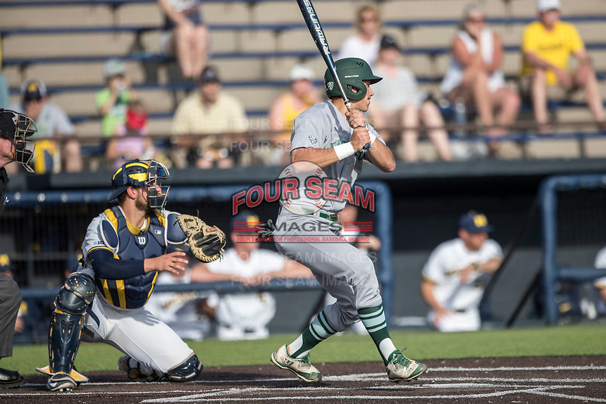 Eastern Michigan Eagles first baseman Zachary Owings (24) follows through on his swing during the NCAA baseball game against the Michigan Wolverines on May 16, 2017 at Ray Fisher Stadium in Ann Arbor, Michigan. Michigan defeated Eastern Michigan 12-4. (Andrew Woolley/Four Seam Images)