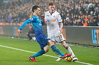 Sam Clucas of Swansea is tackled by Laurent Koscielny of Arsenal during the Premier League match between Swansea City and Arsenal at the Liberty Stadium, Swansea, Wales, UK. Tuesday 30 January 2018