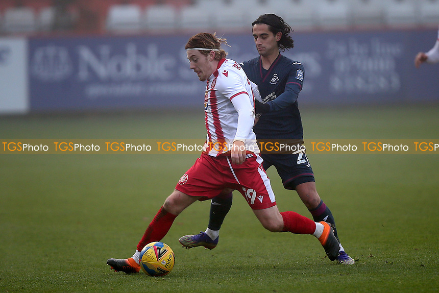 Arthur Read of Stevenage and Yan Dhanda of Swansea City during Stevenage vs Swansea City, Emirates FA Cup Football at the Lamex Stadium on 9th January 2021