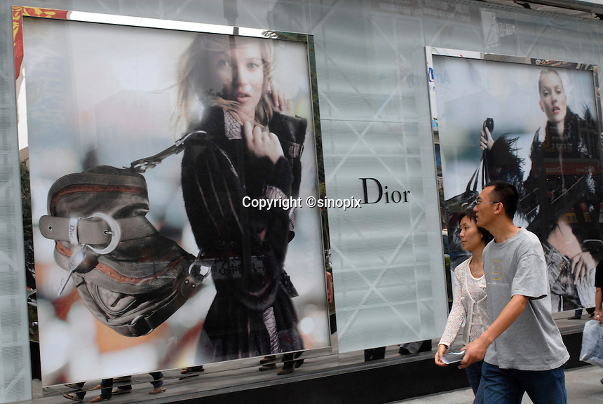 A recently opened Dior shop in the center of a modernised Chengdu. The city is intergral to the Great Western Development Strategy (GWDS), an effort to improve the living standards of the 367 million Chinese.  Dior, like many western cosmetic brands is aggressively expanding in Asia..21 Oct 2006