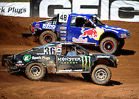 Apr 15, 2011; Surprise, AZ USA; LOORRS driver Rick Huseman (36) and Ricky Johnson (48) during round 3 and 4 at Speedworld Off Road Park. Mandatory Credit: Mark J. Rebilas-.