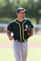 Oakland Athletics second baseman Jeremy Eierman (10) jogs off the field between innings of an Instructional League game against the Los Angeles Dodgers at Camelback Ranch on September 27, 2018 in Glendale, Arizona. (Zachary Lucy/Four Seam Images)