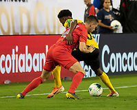 NASHVILLE, TN - JULY 4: Daniel Lovitz #16 and Elvis Powell #5 get tangled up during a game between Jamaica and USMNT at Nissan Stadium on July 4, 2019 in Nashville, Tennessee.