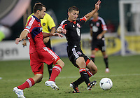 WASHINGTON, DC. - AUGUST 22, 2012:  Perry Kitchen (23) of DC United moves the ball away from  Austin Berry (22) of the Chicago Fire during an MLS match at RFK Stadium, in Washington DC,  on August 22. United won 4-2.