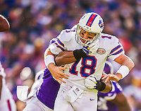 19 October 2014: Buffalo Bills quarterback Kyle Orton fumbles and is taken down in the backfield during the third quarter against the Minnesota Vikings at Ralph Wilson Stadium in Orchard Park, NY. The Bills defeated the Vikings 17-16 in a dramatic, last minute, comeback touchdown drive. Mandatory Credit: Ed Wolfstein Photo *** RAW (NEF) Image File Available ***