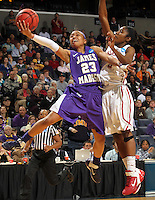 James Madison guard Dawn Evans (23) shoots in front of Oklahoma guard Aaryn Ellenberg (3)during in the first round of the NCAA women's college basketball tournament Sunday March 20, 2011 in Charlottesville, Va. Oklahoma won 86-72. (AP Photo/ Andrew Shurtleff)