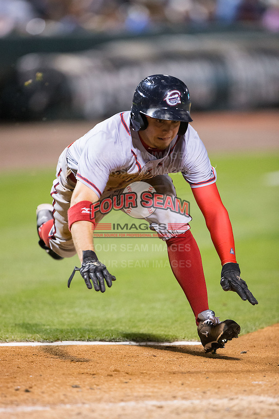 Tony Campana (1) of the Syracuse Chiefs dives head first for home plate against the Charlotte Knights at BB&T BallPark on June 1, 2016 in Charlotte, North Carolina.  The Knights defeated the Chiefs 5-3.  (Brian Westerholt/Four Seam Images)