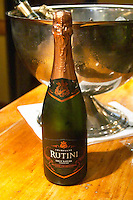 Bottle on a wooden bar counter of Rutini sparkling wine Brut Nature 2000, Metodo Methode Champenoise, Bodega La Rural, Maipu, Mendoza The Rosa Negra Restaurant, The Black Rose, Buenos Aires Argentina, South America San Felipe, La Rural Vinedos y Bodegas Winery