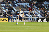 SAINT PAUL, MN - MAY 12: Ranko Veselinovic #4 of Vancouver Whitecaps FC with the ball during a game between Vancouver Whitecaps and Minnesota United FC at Allianz Field on May 12, 2021 in Saint Paul, Minnesota.
