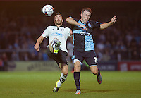 Nikolay Bodurov of Fulham  and Garry Thompson of Wycombe Wanderers battle for the ball during the Capital One Cup match between Wycombe Wanderers and Fulham at Adams Park, High Wycombe, England on 11 August 2015. Photo by Andy Rowland.