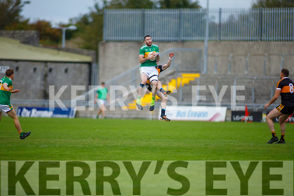 High fielding action as John Mitchels Michael Wren rises above Greg Horan of Austin Stacks in the Tralee Town Board Senior Football Championship final.