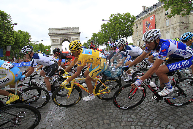 Yellow Jersey Alberto Contador (ESP) Astana in the middle of the peloton first time around the Arc de Triomphe hairpin during the final Stage 20 of the 2010 Tour de France running 102.5km from Longjumeau to Paris Champs-Elysees, France. 25th July 2010.<br /> (Photo by Eoin Clarke/NEWSFILE).<br /> All photos usage must carry mandatory copyright credit (© NEWSFILE | Eoin Clarke)