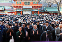Japanese businessmen and women visit the kanda shrine to pray for their good business