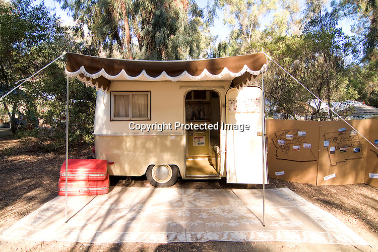 White and tan two-toned 1974 Perris Pacer fiberglass vintage travel trailer.